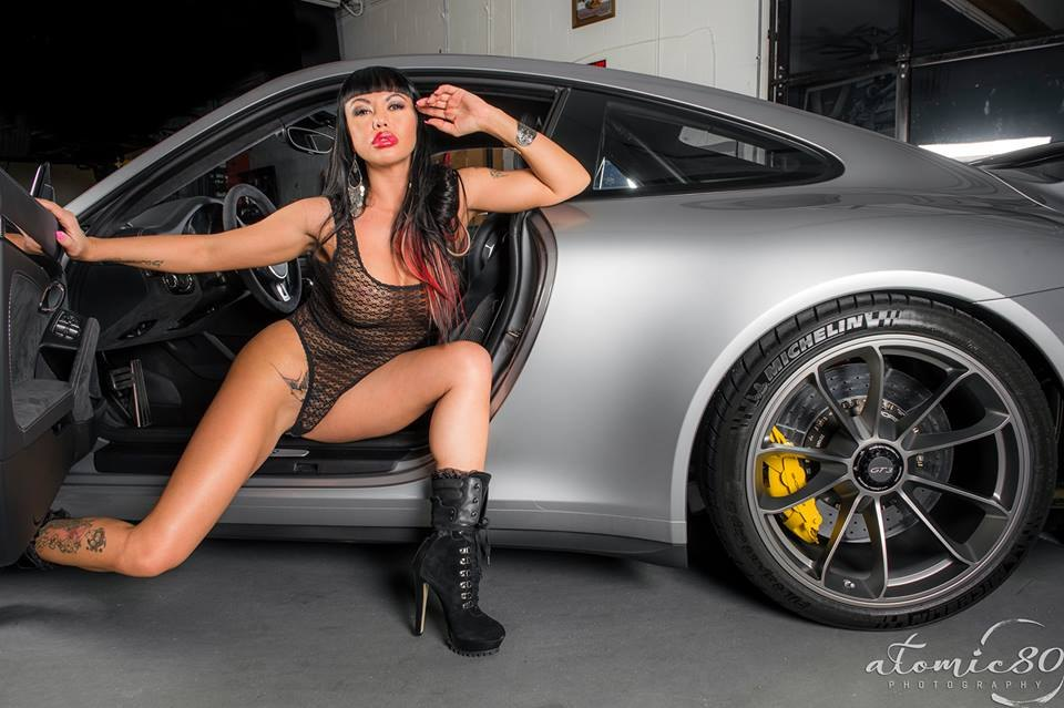 hot girls posing with cars